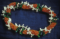 firecracker lei with kukui nut and ti leaf,  and stephanotis (pua male) rope lei, a beautiful and fragrant Hawaiian tradition