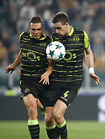 Football Soccer: UEFA Champions League Juventus vs Sporting Clube de Portugal, Allianz Stadium. Turin, Italy, October 18, 2017. <br /> Sporting CP Joao Palhinha (l) and Sebastian Coates (r) in action during the Uefa Champions League football soccer match between Juventus and Sporting Clube de Portugal at Allianz Stadium in Turin, October 18, 2017.<br /> UPDATE IMAGES PRESS/Isabella Bonotto