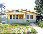 3380 Granada Ave San Diego CA<br />San Diego, California. 1924.  This classic Craftsman bungalow has a neo-classical touch with round pillars on top of the square, porch columns.  The current owners did paint analysis to determine their choice of the historically accurate colors of Sherman William's Colonial Revival Yellow, Colonial Revival Green Slate and Roycroft Vellum.  A simple, two bedroom bungalow when first built, a third bedroom was added in 1935.  Original built-in bookcases, a fold-down desk in the living room, and a dining room sideboard are all still intact, adding to the cottage's comfortable charm.  The owners' renovation in fact has sparked others in the neighborhood to do the same, a sure sign of a successful restoration.  RELEASED