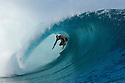 World Champion Kelly Slater from Florida, surfing in Tahiti.