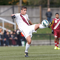Virginia Tech midfielder Niels Kirch (10) volley pass.Boston College (maroon) defeated Virginia Tech (Virginia Polytechnic Institute and State University) (white), 3-1, at Newton Campus Field, on November 3, 2013.