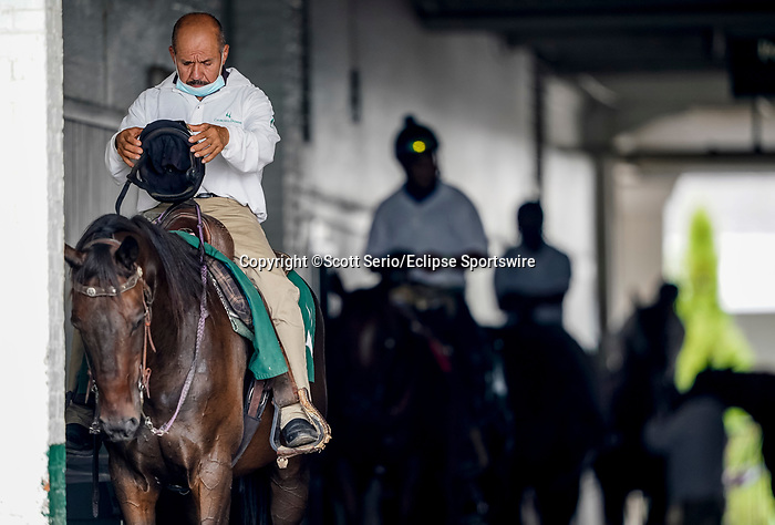 September 1, 2020: A pony rider checks out his helmet in between races on opening day of Kentucky Derby Week at Churchill Downs in Louisville, Kentucky. Scott Serio/Eclipse Sportswire/CSM