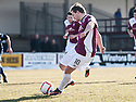 Arbroath's Steven Doris scores their equalising first goal from the spot.