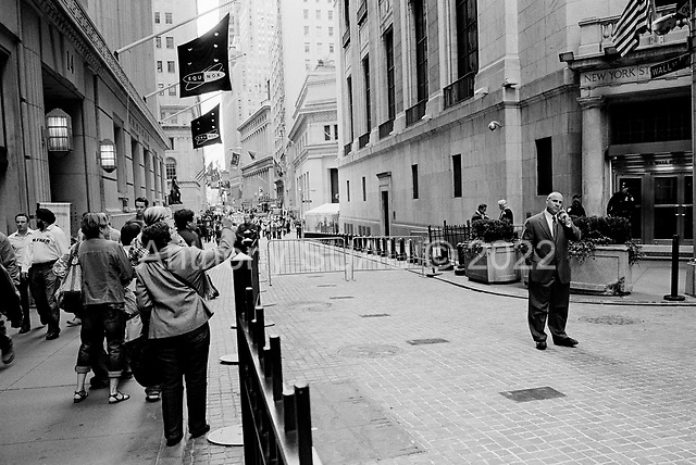 New York, New York<br /> USA<br /> May 2010<br /> <br /> Wall Street traders, investment bankers, musicians, preachers, policemen, security guards, military personal and tourists all make Wall Street and the New York Stock exchange an ever changing three-ring circus were the world of finance and trade come together within a few blocks...Tourists enjoy the traders as the come in and out for the New York Stock Exchange.