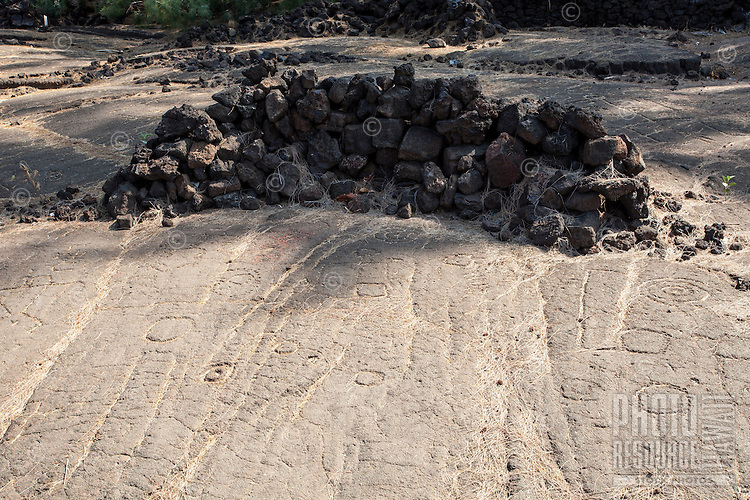 Petroglyphs with rock shelter at the Waikoloa Petroglyph Field (a.k.a. 'Anaeho'omalu Petroglyph Field), Big Island.