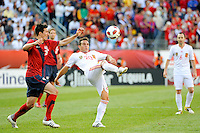 Santiago Cazorla (20) of Spain plays the ball under pressure from Sacha Kljestan (16) of the United States. The men's national team of Spain (ESP) defeated the United States (USA) 4-0 during a International friendly at Gillette Stadium in Foxborough, MA, on June 04, 2011.