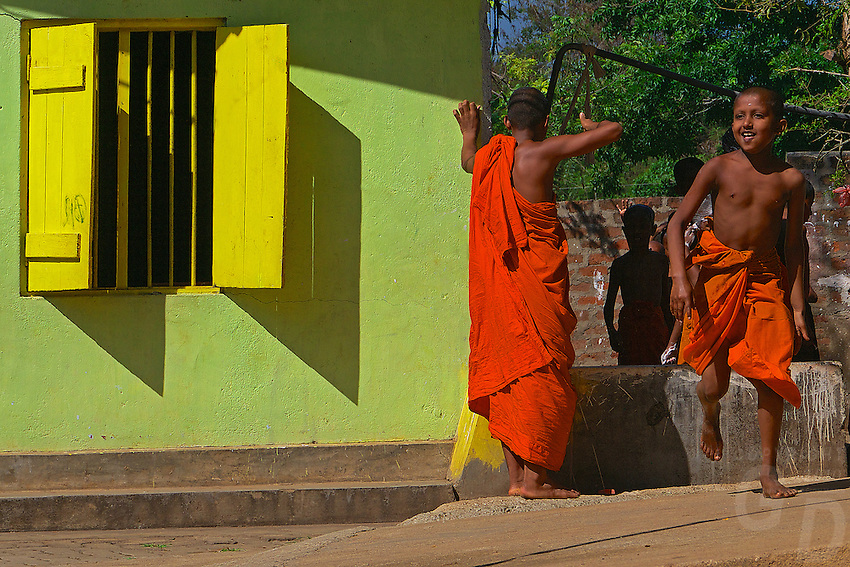 Novice Monks lining up and waiting to get their head shaved at the Kurnagala Wahara Temple and Monastery, Sri Lanka