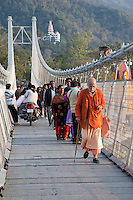India, Rishikesh.  Pedestrians on Suspension Footbridge over the Ganges (Ganga).