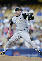 Curt Schilling of the Arizona Diamondbacks pitches during a 2002 MLB season game against the Los Angeles Dodgers at Dodger Stadium, in Los Angeles, California. (Larry Goren/Four Seam Images)