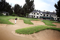 CHINA. A golfer plays a shot from the buker at the Huatang International Golf Club in Beijing. 2009