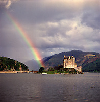 Eilean Donan Castle, Argyll, Western Highlands, Scotland. Against a backdrop of misty mountains and a rainbow, this is the most strikingly situated of Scottish castles and a leading tourist attraction on the road to Skye.