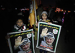 Palestinian Fatah supporter shout slogans during a gathering to celebrate the fiftieth anniversary of the start of the Fatah movement, in Gaza city on December 31, 2014. The Fatah movement was founded by the late iconic leader Yasser Arafat in the 1950s and formally launched its armed struggle against Israel on January 1, 1965. Photo by Ashraf Amra