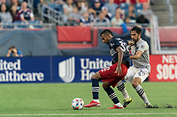 FOXBOROUGH, MA - JULY 25: Christian Mafla #32 of New England Revolution attempts to control the ball asMathieu Choiniere #29 of CF Montreal pressures during a game between CF Montreal and New England Revolution at Gillette Stadium on July 25, 2021 in Foxborough, Massachusetts.