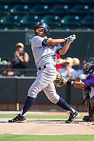 Jack Lopez (11) of the Wilmington Blue Rocks follows through on his swing against the Winston-Salem Dash at BB&T Ballpark on July 6, 2014 in Winston-Salem, North Carolina.  The Dash defeated the Blue Rocks 7-1.   (Brian Westerholt/Four Seam Images)