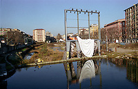 Milano, quartiere ticinese, degrado della Darsena. Cartellone pubblicitario --- Milan, Ticinese district, degradation of the Darsena. Advertising billboard