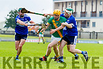 Robert Collins, Kilmoyley in action against Eric Leen, St. Brendan's and Padraig Kearney, St. Brendan's in the Senior Kerry Hurling Championship at Austin Stack Park on Saturday night.