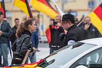 """Rechte demonstrieren in Bautzen gegen Fluechtlinge.<br /> Am Sonntag den 18. September 2016 versammelten sich im saechsischen Bautzen ca. 120 Rechte zu einem Kundgebung mit anschliessender Demonstration um gegen Fluechtlinge zu demonstrieren. Sie riefen Parolen gegen Fluechtlinge und gegen Angela Merkel und beschimpften Medienvertreter als """"Volksverraeter"""".<br /> Nach Aussagen von Anwohnern waren nur etwa 15 Teilnehmer aus Bautzen. Bautzener Rechtsextreme hatten zuvor aufgerufen, sich vorerst nicht an Demonstrationen zu beteiligen, bis ein von ihnen an die Stadtverwaltung gestelltes Ultimatum, zu Loesung der Fluechtlingsfrage verstrichen ist.<br /> Im Bild vlnr.: Ester Seitz aus Bayern, Anmelderin der Veranstaltung und der Dresdner """"Pegida-Anwalt"""" Jens Lorek. <br /> 18.9.2016, Bautzen/Sachsen<br /> Copyright: Christian-Ditsch.de<br /> [Inhaltsveraendernde Manipulation des Fotos nur nach ausdruecklicher Genehmigung des Fotografen. Vereinbarungen ueber Abtretung von Persoenlichkeitsrechten/Model Release der abgebildeten Person/Personen liegen nicht vor. NO MODEL RELEASE! Nur fuer Redaktionelle Zwecke. Don't publish without copyright Christian-Ditsch.de, Veroeffentlichung nur mit Fotografennennung, sowie gegen Honorar, MwSt. und Beleg. Konto: I N G - D i B a, IBAN DE58500105175400192269, BIC INGDDEFFXXX, Kontakt: post@christian-ditsch.de<br /> Bei der Bearbeitung der Dateiinformationen darf die Urheberkennzeichnung in den EXIF- und  IPTC-Daten nicht entfernt werden, diese sind in digitalen Medien nach §95c UrhG rechtlich geschuetzt. Der Urhebervermerk wird gemaess §13 UrhG verlangt.]"""