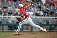 Louisville Cardinals pitcher Bobby Miller (15) delivers a pitch to the plate during Game 7 of the NCAA College World Series against the Auburn Tigers on June 18, 2019 at TD Ameritrade Park in Omaha, Nebraska. Louisville defeated Auburn 5-3. (Andrew Woolley/Four Seam Images)