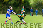 Jason Hickson of Annascaul gives a helping hand to Shane O'Connell of Knocknagoshel in the Kerry Junior Club Championship round 1 game on Sunday.