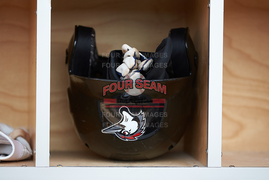 A Fayetteville Woodpeckers batting helmet sits in a cubby hole in the home dugout prior to the game against the Salem Red Sox at Segra Stadium on May 15, 2019 in Fayetteville, North Carolina. The Woodpeckers defeated the Red Sox 6-2. (Brian Westerholt/Four Seam Images)
