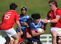 Meihana Grindlay is tackled during the 2021 Bunnings Super Rugby Aotearoa Under-20 rugby match between the Barbarians and Blues at Owen Delaney Park in Taupo, New Zealand on Tuesday, 14 April 2020. Photo: Dave Lintott / lintottphoto.co.nz