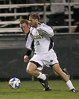 Ryan Miller #2 of Notre Dame pushes past Endre Osnes #18 of Oakland. The University of Notre Dame defeated Oakland University 2-1 in the second round of the NCAA championship at Alumni Field at the University of Notre Dame in South Bend, Indiana on November 28, 2007.