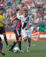 LA Galaxy substitute midfielder Robbie Rogers (14) on the attack.  In a Major League Soccer (MLS) match, the New England Revolution (blue) defeated LA Galaxy (white), 5-0, at Gillette Stadium on June 2, 2013.