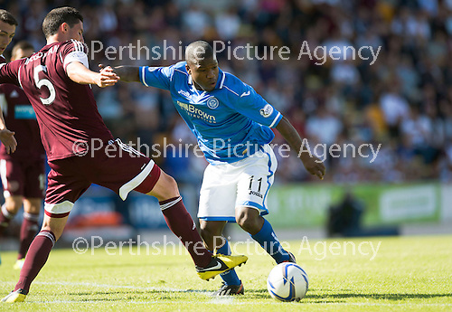 St Johnstone v Hearts...04.08.13 SPFL<br /> Nigel Hasselbaink fends off Dylan McGowan<br /> Picture by Graeme Hart.<br /> Copyright Perthshire Picture Agency<br /> Tel: 01738 623350  Mobile: 07990 594431