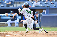 Augusta GreenJackets center fielder Ismael Munguia (34) swings at a pitch during a game against the Asheville Tourists at McCormick Field on April 7, 2019 in Asheville, North Carolina. The GreenJackets  defeated the Tourists 11-2. (Tony Farlow/Four Seam Images)