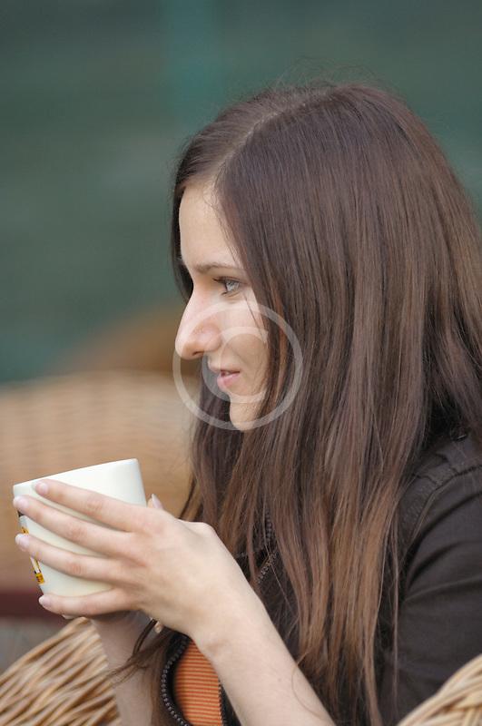 Poland, Krakow, Woman at café