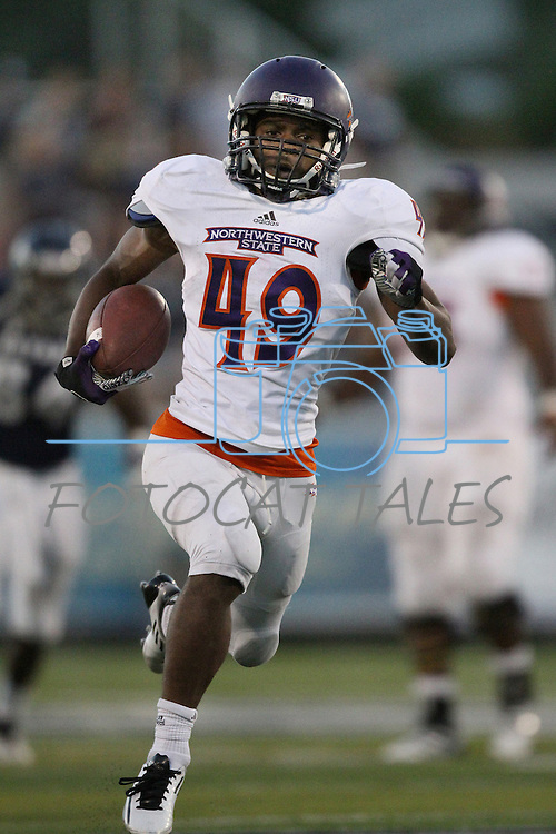 Northwestern State's Daniel Taylor (49) runs for the end zone and eventually scores during the second half of an NCAA college football game Saturday, Sept. 15, 2012, in Reno, Nev. (AP Photo/Cathleen Allison)