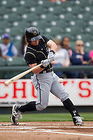 Omaha Storm Chasers second baseman Johnny Giavotella #9 swings the bat against the Round Rock Express in the Pacific Coast League baseball game on April 7, 2013 at the Dell Diamond in Round Rock, Texas. Omaha beat Round Rock 5-2, handing the Express their first loss of the season. (Andrew Woolley/Four Seam Images).