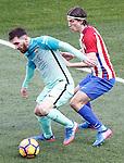 Atletico de Madrid's Filipe Luis (r) and FC Barcelona's Leo Messi during La Liga match. February 26,2017. (ALTERPHOTOS/Acero)