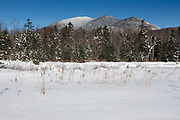 Mount Carrigain from a viewpoint near the Sawyer River Trail in Livermore, New Hampshire during the winter months. This area was logged during the Sawyer River Railroad era (1877-1928), and the Sawyer River Trail follows part of the railroad bed. Mount Carrigain is a popular day hike.