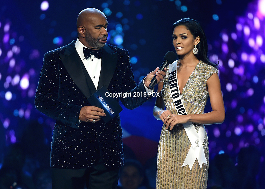 BANGKOK, THAILAND - DECEMBER 17:  Steve Harvey andMiss Puerto Rico Kiara Ortega onstage on the 2018 MISS UNIVERSE competition at the Impact Arena in Bangkok, Thailand on December 17, 2018. (Photo by Frank Micelotta/FOX/PictureGroup)