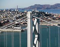 aerial photograph of San Francisco Oakland Bay Bridge toward Coit tower and the Golden Gate Bridge