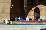 Cairo, Egypt -- I was struck by the bright colors of these inexpensive and modern chairs, all neatly aligned in front of one of the iwans inside this historic site, the Sultan Hassan mosque.   © Rick Collier / RickCollier.com.