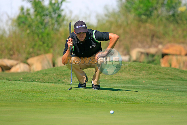 Martin Kaymer (GER) lines up his putt on the 13th green during the morning Semi-Final session on the Final Day of the Volvo World Match Play Championship in Finca Cortesin, Casares, Spain, 22nd May 2011. (Photo Eoin Clarke/Golffile 2011)