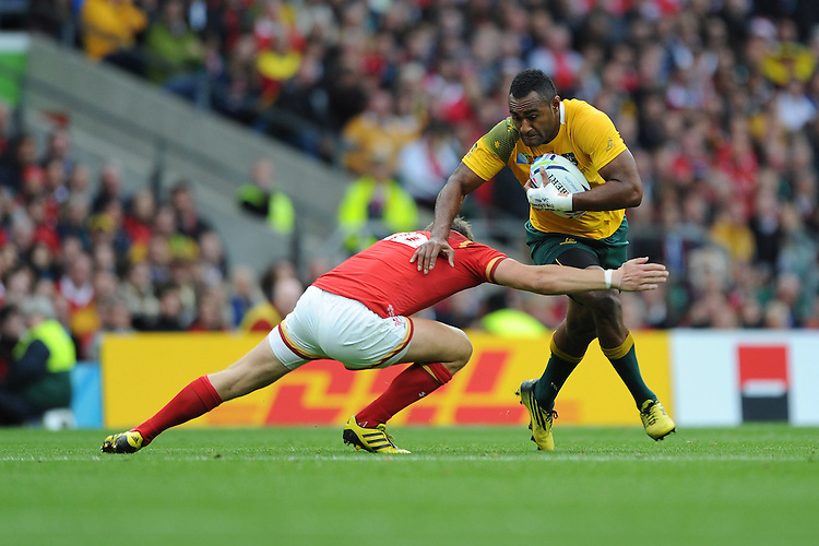 Tevita Kuridrani of Australia attempts to hand off Dan Biggar of Wales during Match 35 of the Rugby World Cup 2015 between Australia and Wales - 10/10/2015 - Twickenham Stadium, London<br /> Mandatory Credit: Rob Munro/Stewart Communications
