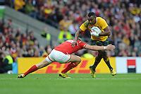 Tevita Kuridrani of Australia attempts to hand off Dan Biggar of Wales during Match 35 of the Rugby World Cup 2015 between Australia and Wales - 10/10/2015 - Twickenham Stadium, London<br /> Mandatory Credit: Rob Munro/Stewart Communications