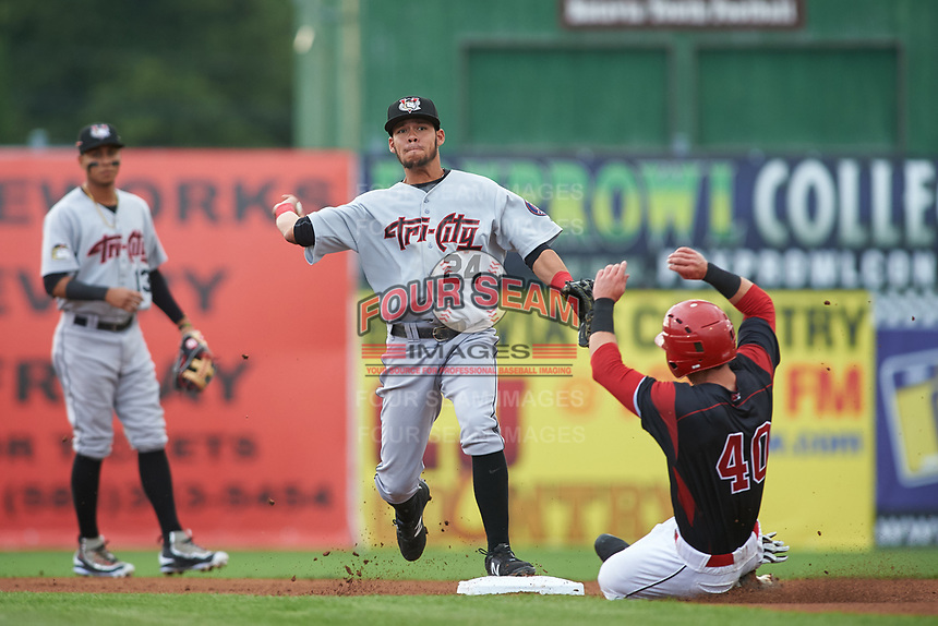 Tri-City ValleyCats second baseman Kristian Trompiz (24) throws to first base to try and complete a double play during a game against the Batavia Muckdogs on July 14, 2017 at Dwyer Stadium in Batavia, New York.  Batavia defeated Tri-City 8-4.  (Mike Janes/Four Seam Images)