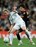 Real Madrid's Guti (f) and Roma's Roberto Aquilani (b) during the UEFA Champions League match between Real Madrid and Roma at Santiago Bernabeu Stadium in Madrid, Wednesday March 05 2008. (ALTERPHOTOS/Acero).