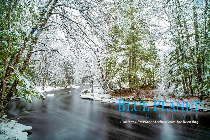 tranquil winter scene, landscape along Bear River after heavy snowfall, Nova Scotia, Canada
