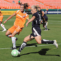 Washington Freedom  midfielder Lori Lindsey (6) plans her pass, strongly watched by Sky Blue defender Keeley Dowling (17).  Washington Freedom defeated Sky Blue FC 2-1 at RFK Stadium, Saturday May 23, 2009.