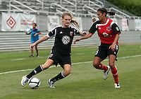 BOYDS, MARYLAND - July 21, 2012:  Hayley Siegel (12) of DC United Women pulls the ball past Megan Weston (16) of the Virginia Beach Piranhas during a W League Eastern Conference Championship semi final match at Maryland Soccerplex, in Boyds, Maryland on July 21. DC United Women won 3-0.
