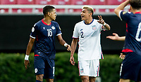 ZAPOPAN, MEXICO - MARCH 21: Julian Araujo #2 of the United States and Josue Baez #16 of the Dominican Republic exchange a few words during a game between Dominican Republic and USMNT U-23 at Estadio Akron on March 21, 2021 in Zapopan, Mexico.