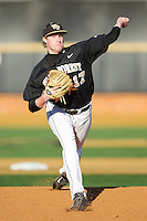 Wake Forest Demon Deacons starting pitcher John McLeod (17) delivers a pitch to the plate against the Georgetown Hoyas at Wake Forest Baseball Park on February 16, 2014 in Winston-Salem, North Carolina.  The Demon Deacons defeated the Hoyas 3-2.  (Brian Westerholt/Four Seam Images)