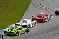 #99 GAINSCO/Bob Stallings Racing Pontiac/Riley of Jon Fogarty & Alex Gurney leads the #23 Porsche/Crawford and the #75 Pontiac/Riley