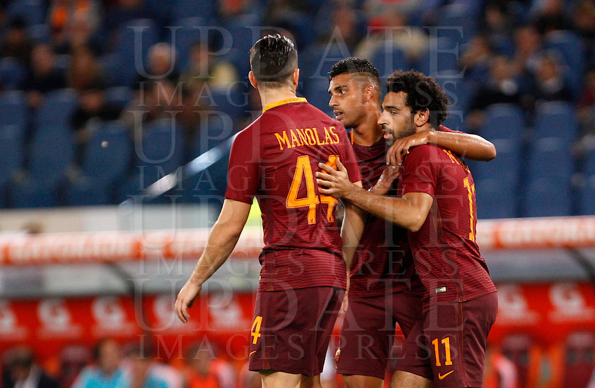 Calcio, Serie A: Roma vs Palermo. Roma, stadio Olimpico, 23 ottobre 2016.<br /> Roma's Mohamed Salah, right, celebrates with teammates, from left, Kostas Manolas and Emerson Palmieri, after scoring during the Italian Serie A football match between Roma and Palermo at Rome's Olympic stadium, 23 October 2016. Roma won 4-1.<br /> UPDATE IMAGES PRESS/Riccardo De Luca