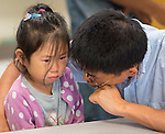 Parents bring their students to the first day of school at Shearn Elementary School, August 25, 2014.